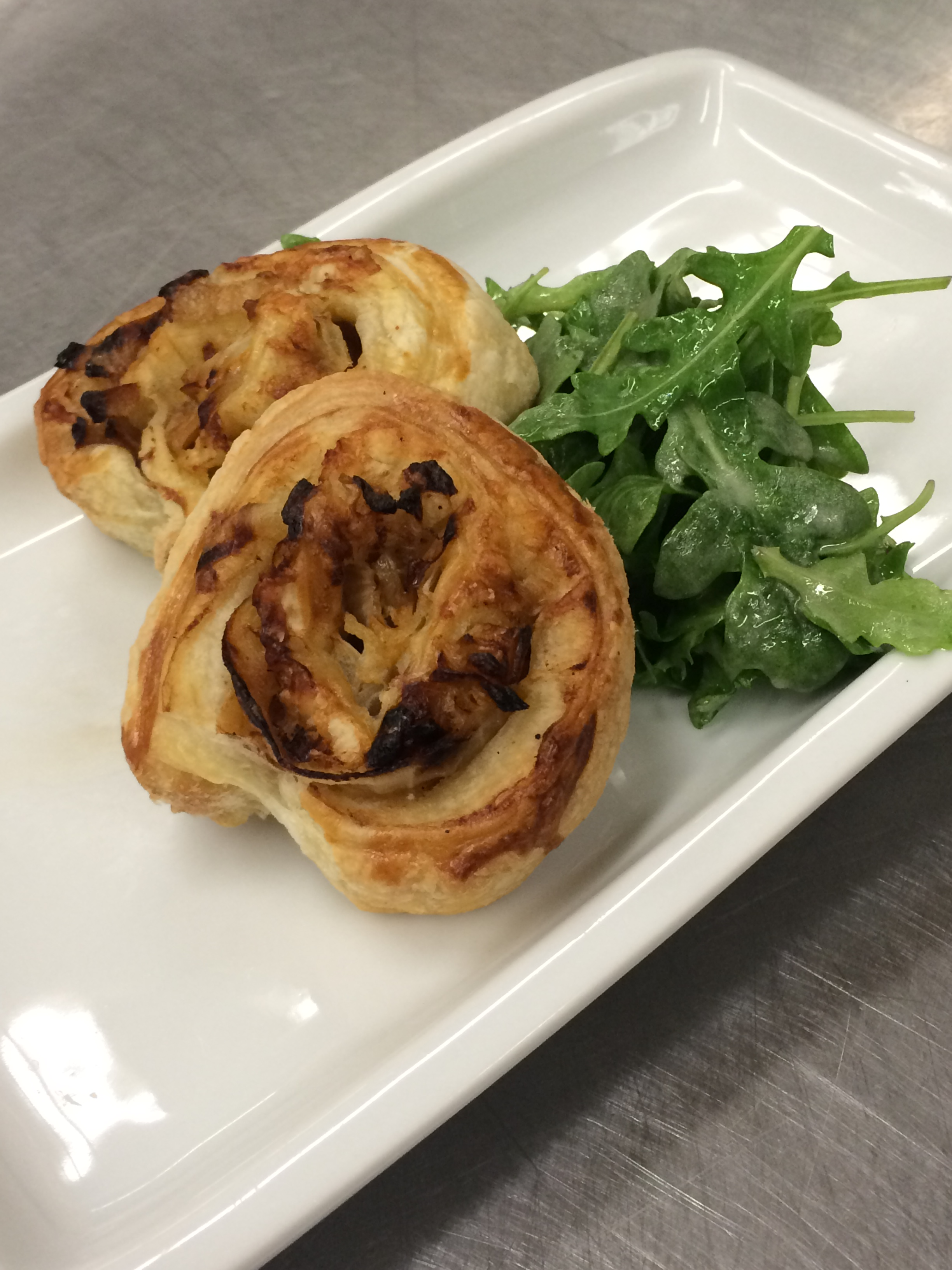 French Onion Soup Inspired Small plates: puff pastry spiral with caramelized onions and gruyere cheese.  Gourmet Small Plates by LeCroissant Catering & Events Gourmet Small Plates by LeCroissant Catering & Events 2015 07 30 17