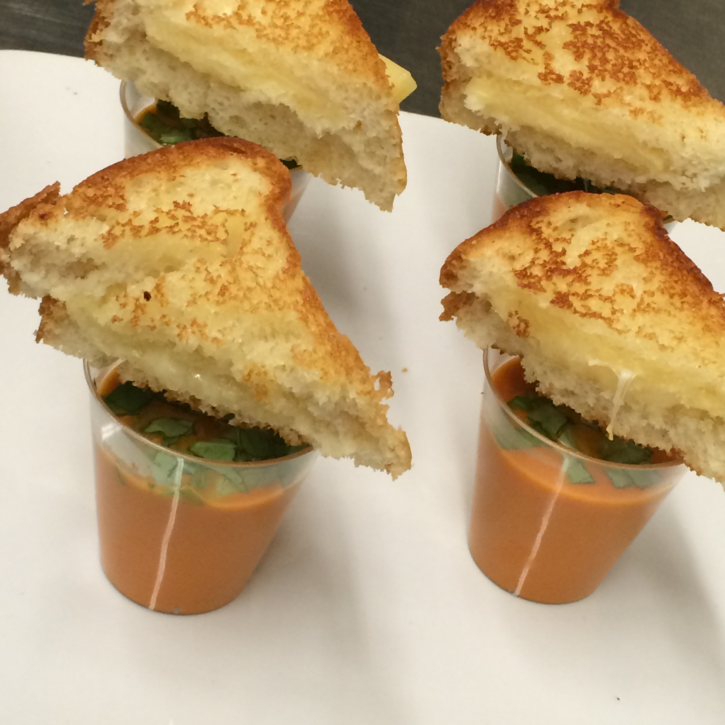 Creamy tomato soup shooters served with mini grilled cheese sandwiches small plates from LeCroissant Catering & Events Gourmet Small Plates by LeCroissant Catering & Events Gourmet Small Plates by LeCroissant Catering & Events 2015 07 30 18