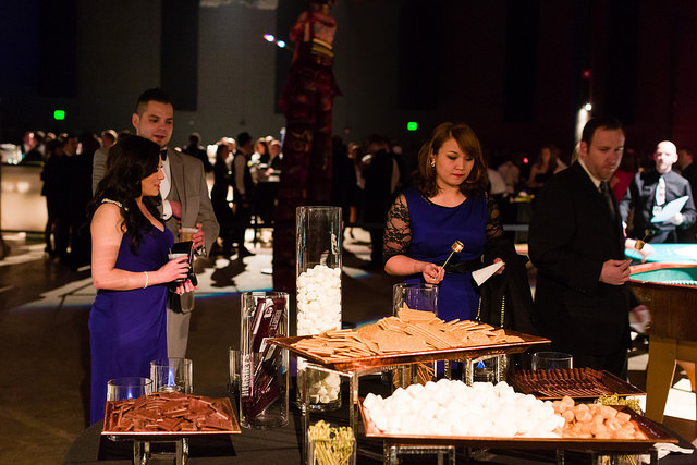 Guests enjoying the live action s'mores bar. Available for your next event with LeCroissant Catering & Events.  Celebrate National S'mores Day with a S'mores Bar! Celebrate National S'mores Day with a S'mores Bar! 14714467197 63687a29a6 z